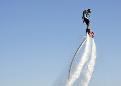 Flyboarder high in the sky
